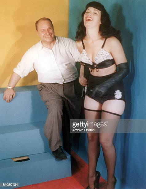 American model Bettie Page with photographer Irving Klaw circa 1955