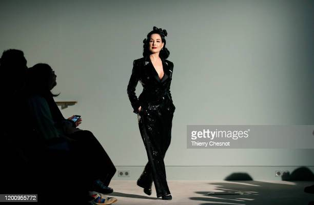 American model Dita von Teese walks the runway during the Alexis Mabille Haute Couture Spring/Summer 2020 show as part of Paris Fashion Week on...