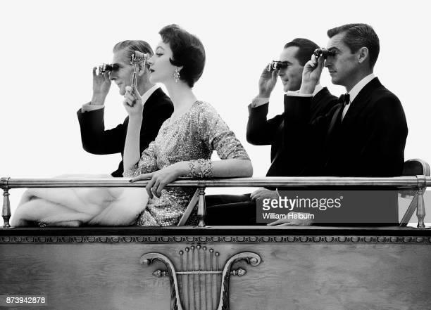 american model Dovima posing in an opera box with three male models circa 1961