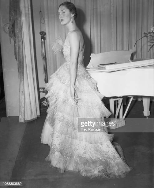 American model Jane Burns wearing 'Mozart', a champagne tulle evening gown by French fashion designer Christian Dior, during a show of ninety new...