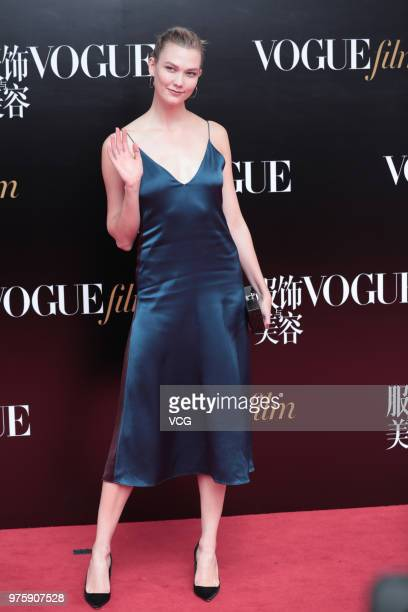 American model Karlie Kloss poses on the red carpet of 2018 Vogue Film Gala on June 15 2018 in Shanghai China