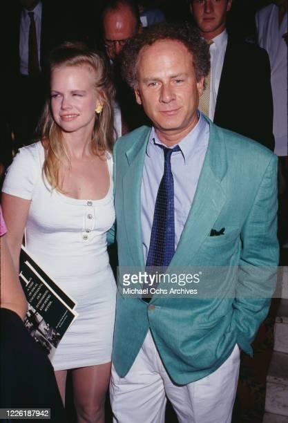 American model Kim Garfunkel and her husband American singer and actor Art Garfunkel attend an unspecified event circa 1990