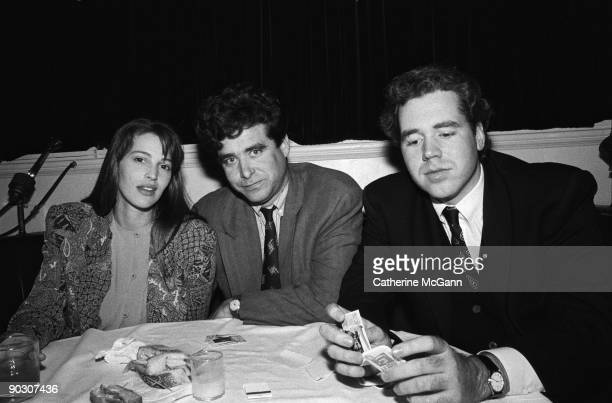 American model Marla Hanson poses for a photo with American authors Jay McInerney and Bret Easton Ellis at a party for the premiere of John Waters'...