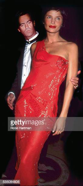 American model Paul Beck and Danish model Helena Christensen attend the 13th Annual Night of Stars at the Pierre Hotel New York New York 1996
