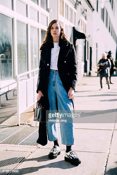 American model Ruby Aldridge wears a black peacoat white top cropped high waisted jeans and black and white yin yang platform creepers shoes after...