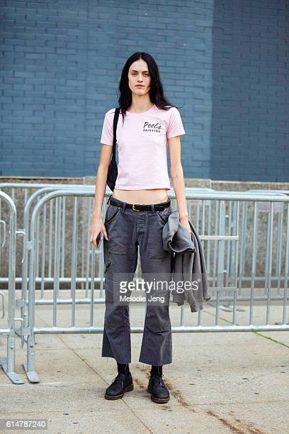 American model Sarah Brannon wears a pink Peel's painting tshirt dark pants and Doc Marten style oxford shoes after the Lacoste show at Spring...