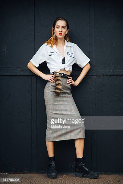 American model Teddy Quinlivan keeps the red lipstick from the Jason Wu show and wears pearl earrings a Peels janitorstyle shirt cropped/tied under...