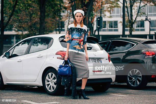 American model Teddy Quinlivan wears a Prada hat and Impossible True Love shirt and blue Loewe purse after the Loewe show at Maison de l'Unesco on...