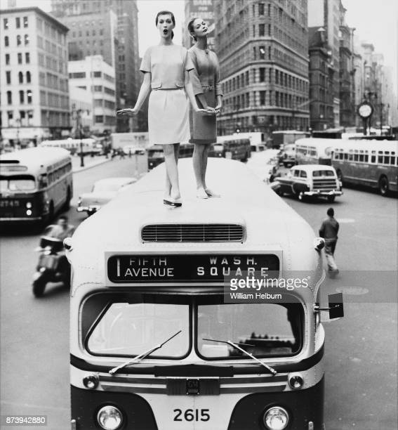 American models Dovima and Jean Patchett posing on top of a bus Madison Square New York December 1958 For Harper's Bazaar 'The Skirt's The Thing'