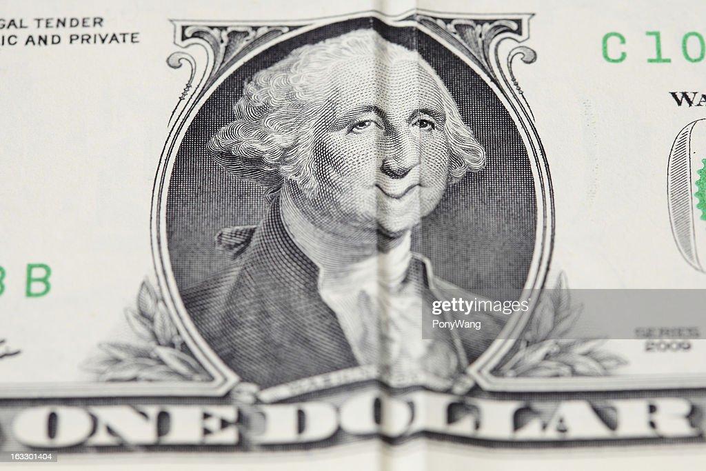 american money One dollar with washington smile : Stock Photo