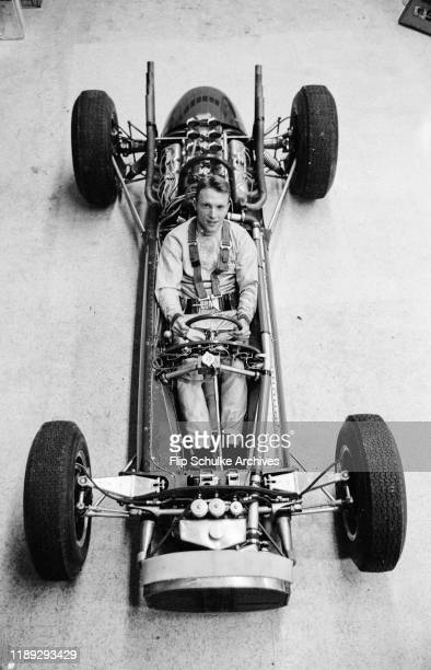 American motor racing driver Dan Gurney sitting in the Lotus-Ford race car during its first testing at Indy, March 1963.