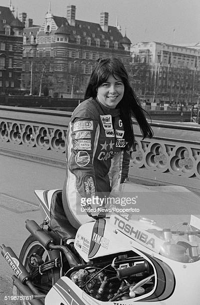 American motorcycle racer Gina Bovaird pictured with her Yamaha motorbike on Westminster bridge in London on 21st February 1980.