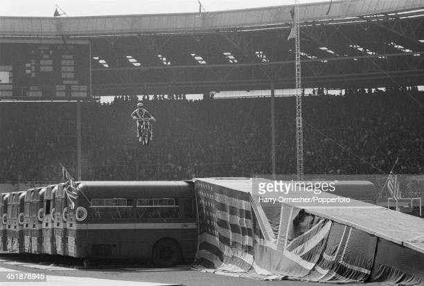 American motorcycle stunt rider Evel Knievel attempts to jump 13 AEC Merlin buses at Wembley Stadium London 26th May 1975 Knievel crashed his...
