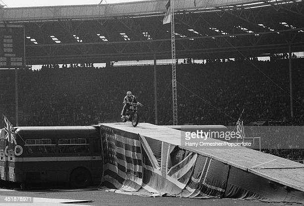 American motorcycle stunt rider Evel Knievel touches down after jumping his HarleyDavidson XR750 over 13 AEC Merlin buses at Wembley Stadium London...