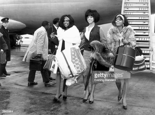 American Motown band The Supremes left to right Mary Wilson Florence Ballard and Diana Ross arrive at London's Heathrow Airport