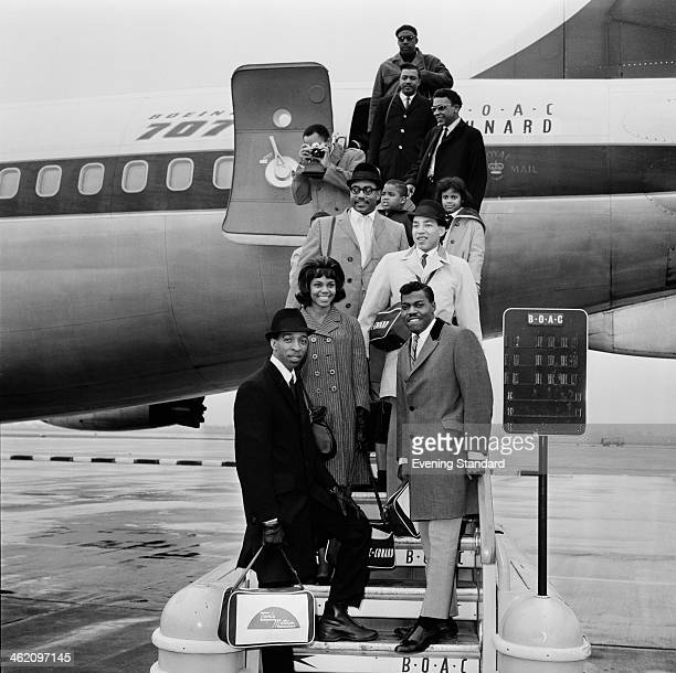 American Motown rhythm and blues group The Miracles arriving at London Airport London 15th March 1965 Clockwise from bottom left Ronnie White...