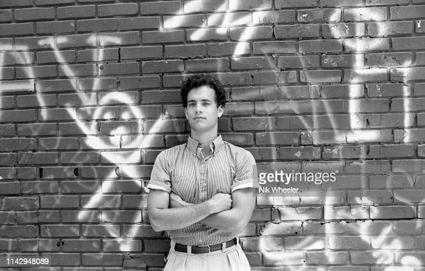 BURBANK JANUARY 1984 American movie actor Tom Hanks stands in front of graffiti wall on the backlot of 20 Century Fox Studio in Century City...