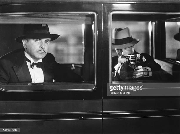 American movies in the 1930ies Armed gangsters in a car scene from a movie dealing with the smuggling of alcohol during the prohibition in the US USA...