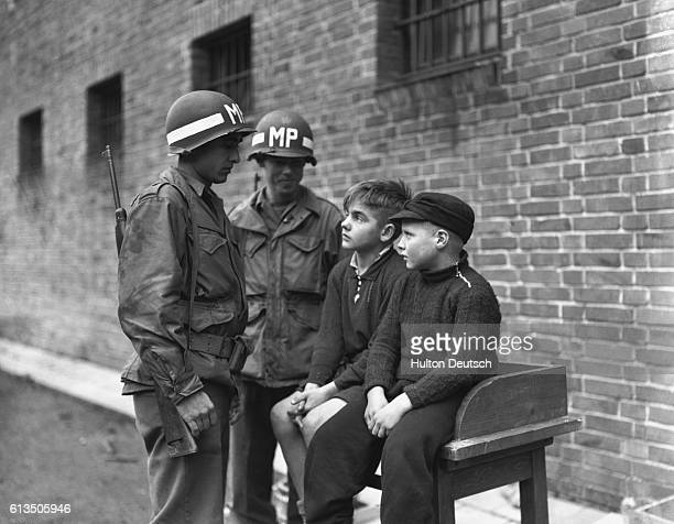 American MPs question Willy Etechenberg 14 and Hubert Heinrichs aged 10 at Aachen Germany in 1944 The two children members of the Hitler Youth...
