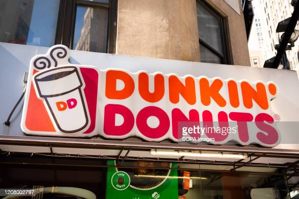 American multinational coffeehouse and donut company Dunkin' Donuts store logo seen in New York City