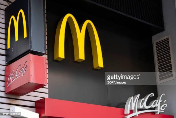 American multinational fast-food hamburger restaurant chain, McDonald's and McCafe logos in Hong Kong.