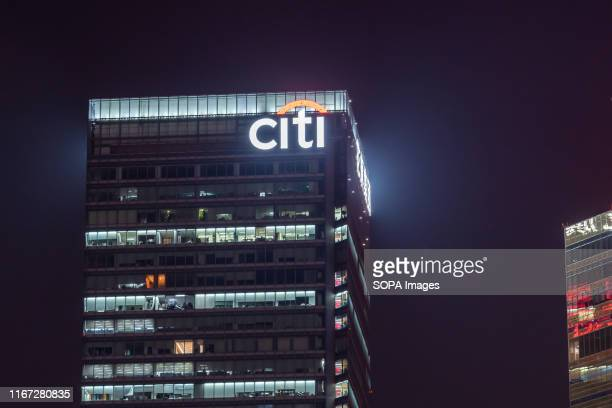American multinational investment bank and financial services corporation Citigroup, or Citi, logo seen on top of a modern skyscraper in Shanghai.