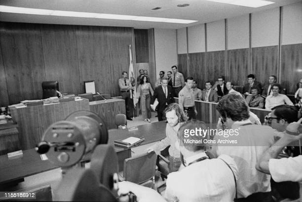 American murderer and member of the Manson Family Susan Atkins and American defense attorney Irving Kanarek enter the court room at the Santa Monica...