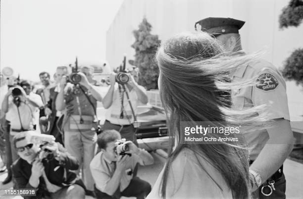American murderer and member of the Manson Family Susan Atkins is escorted by Los Angeles County sheriffs to the Santa Monica Courthouse to appear in...