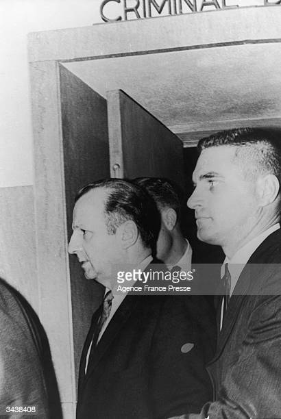 American murderer Jack Ruby is escorted into a courtroom by detectives Ruby was on trial for the murder of Lee Harvey Oswald President John F...
