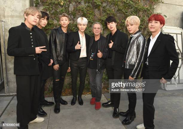 American Music Awards producer Larry Klein and music group BTS attend the 2017 American Music Awards at Microsoft Theater on November 19 2017 in Los...