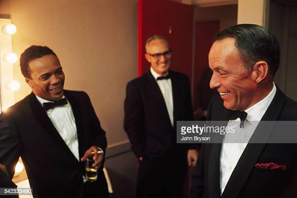 American music conductor record producer film composer and trumpeter Quincy Jones and singer and actor Frank Sinatra in Sinatra's dressing room