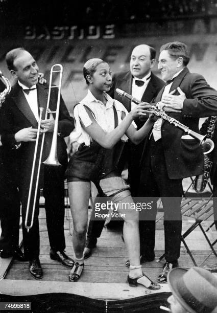 American music hall star Josephine Baker playing the clarinet at the Caf' Conc festival at the Stade Buffalo velodrome Montrouge Paris 1926 Fte des...