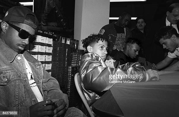 American music producer and rapper Jermaine Dupri left with sunglasses attends a record signing with the group he discovered and produced American...