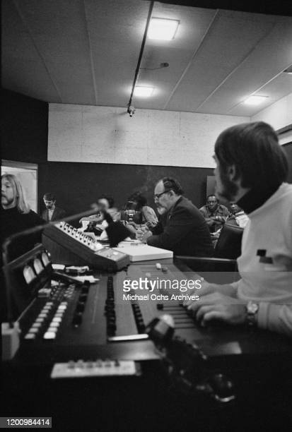 American music producer Jerry Wexler , American recording engineer and producer Tom Dowd and American musician Duane Allman during the recording...