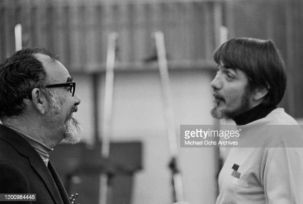 American music producer Jerry Wexler and American recording engineer and producer Tom Dowd during a recording session of Aretha Franklin's studio...