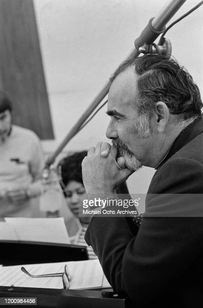 American music producer Jerry Wexler with American singer, songwriter, pianist, and civil rights activist Aretha Franklin , and American recording...