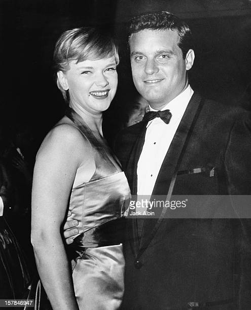 American musical arranger and composer Buddy Bregman with actress Anne Francis at the Costumers' Awards party USA circa 1957