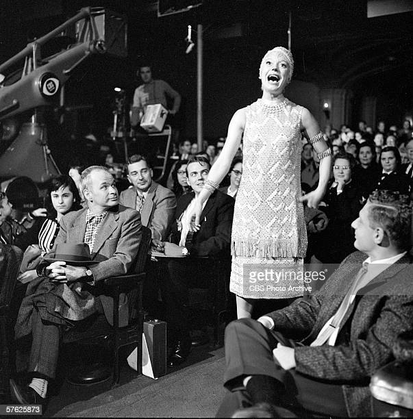 American musical theater actress Carol Channing sings in the aisle amid the audience on Ed Sullivan's CBS variety show 'Toast of the Town' New York...