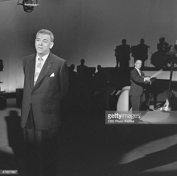 American musical writer producer and director Oscar Hammerstein appears on stage with an orchestra in the background on 'The Ed Sullivan Show' New...
