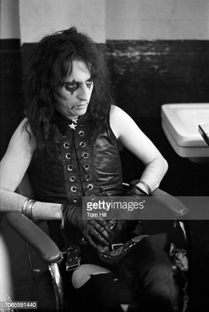 Alice Cooper relaxes with his boa constrictor in the dressing room before performing during the 'Killer' tour at The Atlanta Municipal Auditorium on...