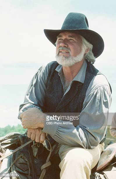 American musician and actor Kenny Rogers sits in the saddle in character as Brady Hawkes in a publicity photo for the CBS televison movie 'The...