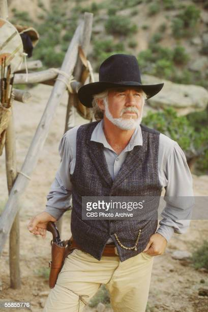 American musician and actor Kenny Rogers stands with his hand on the grip of his pistol in character as Brady Hawkes in a publicity photo for the CBS...
