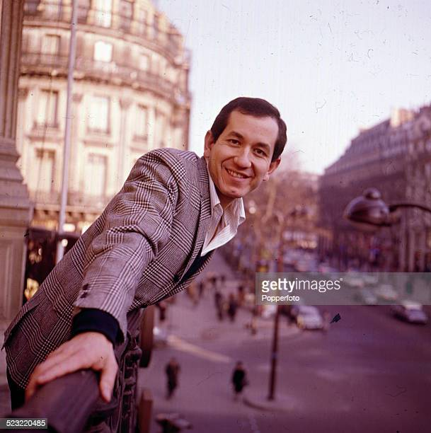 American musician and actor Trini Lopez pictured standing on a hotel balcony in Paris in 1964