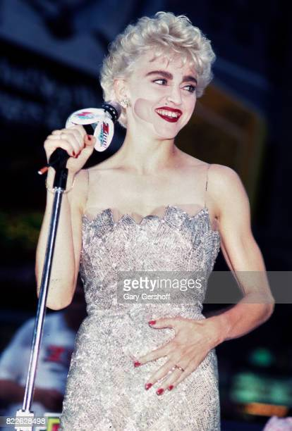 American musician and actress Madonna addresses fans outside the gala world premiere of her film 'Who's That Girl' at the National Twin cinema New...