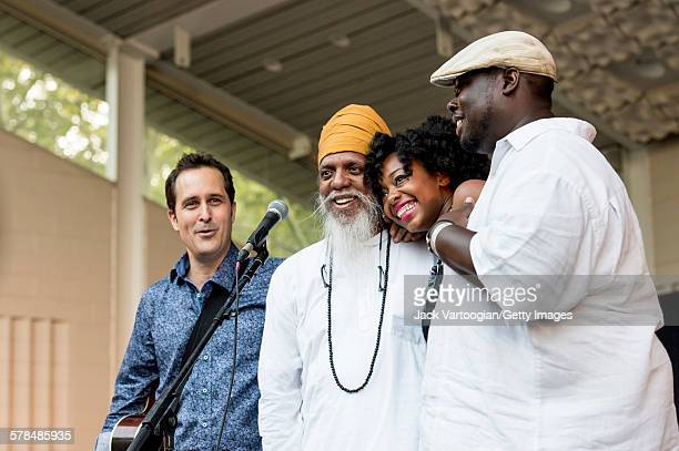 American musician and bandleader Dr Lonnie Smith and his band take a bow on the second day of the 23rd Annual Charlie Parker Jazz Festival in the...