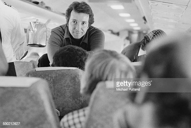 American musician and bandleader Herb Alpert on board a plane during his European Tour with the TJB a new linup of the Tijuana Brass 25th September...