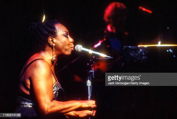American musician and Civil Rights activist Nina Simone plays piano as she performs at the Beacon Theater New York New York May 1 1993 Obscured in...