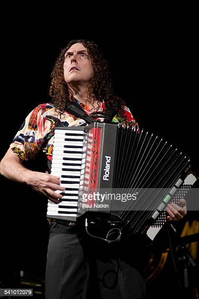 American musician and comedian Weird Al Yankovic plays an accordion as he performs onstage at the Star Plaza Theater Merrillville Indiana July 9 2010
