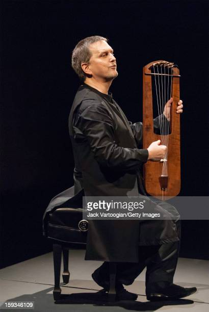 American musician and composer Benjamin Bagby plays a sixstring lyre during a performance of his adaptation of the AngloSaxon epic 'Beowulf' for the...