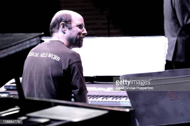 American musician and composer Brad Hatfield seated at a keyboard during a rehearsal in London on 13th June 2003.